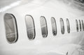 Passenger aircraft windows. Royalty Free Stock Photo