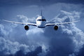 Passenger airliner flying in the clouds Stock Photo