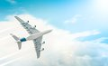 Passenger airplane flying in blue cloudy sky. Royalty Free Stock Image