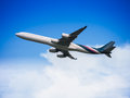 Passenger airplane flying in the sky large concept of travelling abroad Royalty Free Stock Image