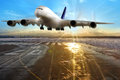 Passenger airplane landing on runway in airport. Royalty Free Stock Photo