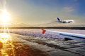 Passenger airplane landing on runway in airport. Evening Royalty Free Stock Photo
