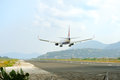 Passenger airplane landing to active runway Royalty Free Stock Photos
