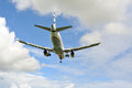 Passenger airplane landing to active runway Stock Photography