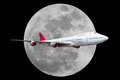 Passenger airplane with moon  on black background Royalty Free Stock Photo