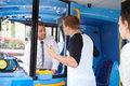 Passenger arguing with bus driver raising his hands girl in background Royalty Free Stock Photography