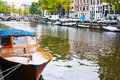 Passenger boat on the Herengracht canal in Amsterdam