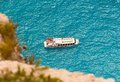Passenger boat at ionian sea tourist floating on the turquoise in zakynthos greece Royalty Free Stock Photos