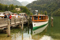 Passenger boat and pier konigssee germany a cruise waiting for passengers Stock Photo