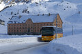 Passenger bus on snowy mountain pass top Royalty Free Stock Photo