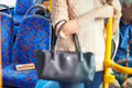 Passenger leaving change purse on seat of bus walking away Royalty Free Stock Photo