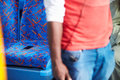 Passenger leaving mobile phone on seat of bus walking away Stock Image