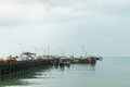 Passenger pier with many cars and boats Royalty Free Stock Photo