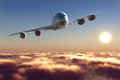 Passenger plane above the clouds Stock Image