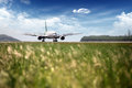 Passenger plane fly up over take-off runway Royalty Free Stock Photo