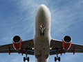 Passenger plane landing overhead Stock Photo