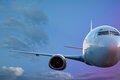 Passenger plane large flying in the blue sky Royalty Free Stock Photo