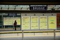 Passenger reads timetable at brugge railway station belgium november a lone on a platform the train is a Royalty Free Stock Photo