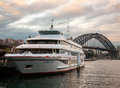 Passenger ship is anchored at the circular quay sydney australia july in sydney harbour bridge on background of a cruise Stock Photo