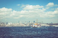 Passenger ship in istanbul on water and mosque on horizon Royalty Free Stock Images