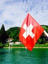 Passenger ship and swiss flag in Thun lake Royalty Free Stock Photo