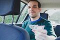 Passenger in taxi paying by cash Royalty Free Stock Photo