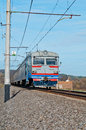 Passenger train hauled by electric locomotive Royalty Free Stock Photo