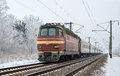 Passenger train hauled electric locomotive ukrainian railway Stock Photography