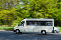 A passenger van in motion Royalty Free Stock Photo