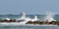 Passenger yacht speeds along the ocean boat in sea surf on coast of cyprus Stock Image
