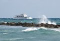 Passenger yacht speeds along the ocean boat in sea surf on coast of cyprus Stock Photo