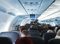 Passengers in airplane cabin interior Stock Photos