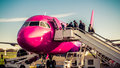 Passengers boarding to wizzair company plane in paris beauvais airport Royalty Free Stock Photography