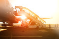 Passengers climb the ladder to board a large airliner at the airport. Royalty Free Stock Photo