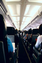 Passengers Onboard Plane Stock Photo