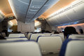 Passengers sit in flight during travel abroad in airplane. Royalty Free Stock Photo