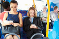Passengers sitting on bus sending text messages horizontal image of Royalty Free Stock Photos