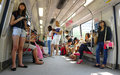Passengers in the train mrt singapore february singapore subway also known as started operating it is network length is kms Stock Images