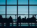 Passengers wait for their flight in london airport Stock Photos