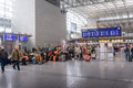 Passengers waiting in a departures hall Royalty Free Stock Photo