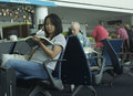 Passengers waiting for flight Royalty Free Stock Photo