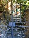 Passignano sul Trasimeno ancient town, Umbria region, Italy. Secret garden and gate Royalty Free Stock Photo