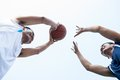 Passing the ball angle view of basketball players outside Royalty Free Stock Photography