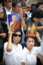 Passing of the thai sumpreme patriarch roadside mourners hold portraits supreme somdet phra nyanasamvara as a convoy carries his Stock Images