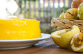 Passion fruit cake on wood background closeup white plate with and garden view Royalty Free Stock Photo