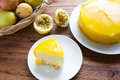 Passion fruit cake on wood background white plate wooden and in a basket homemade Royalty Free Stock Image