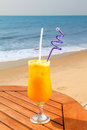 Passion fruit juice ice table against background sea sky Royalty Free Stock Images