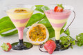 Passion fruit and strawberry mousse two glasses of horizontal composition Royalty Free Stock Photography
