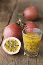 Passion fruits with glass of passion fruit juices on wooden. Royalty Free Stock Photo