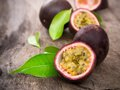 Passion fruits on wooden background Royalty Free Stock Photo